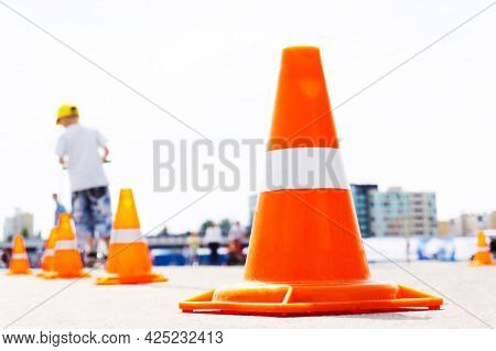 Traffic Cones. Restricting Traffic On A City Street During Road Works. Foreground
