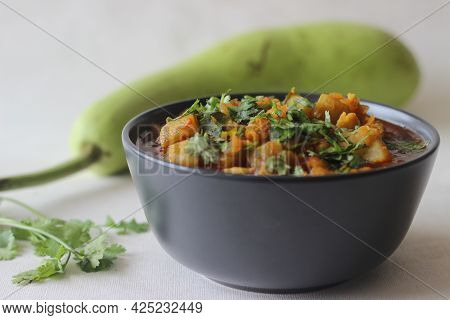 Bottle Gourd Curry With Lentils. One Pot Chickpea Lentil Dish Cooked With Bottle Gourd Onions Tomato