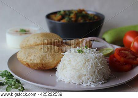 North Indian Vegetarian Meals. One Pot Preparation Of Lentil And Bottle Gourd Served With Steamed Ba