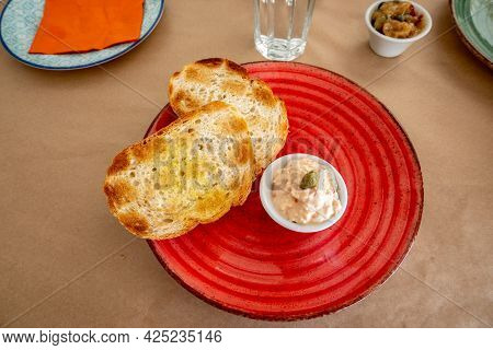 Toast With Cheese Sauce, A Typical Starter In A Greek Restaurant. Paros Island, Greece