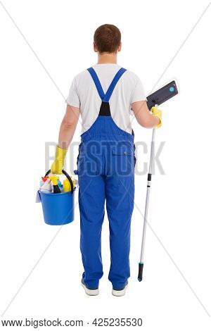 Back View Of Male Cleaner In Blue Uniform And Yellow Gloves Holding Mop And Bucket With Cleaning Equ