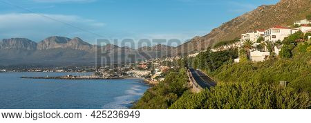 Panoramic View Of Gordons Bay In The Western Cape Province. The Harbour Is Visible
