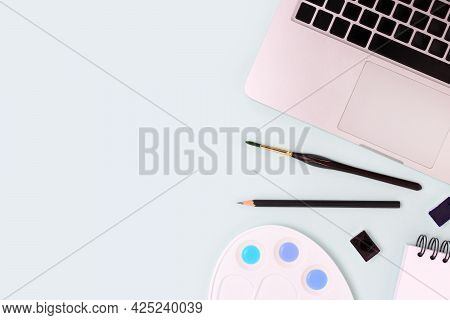 Banner With Office Supplies And Laptop On A Gray And Yellow Background. Neat Workspace For Distance