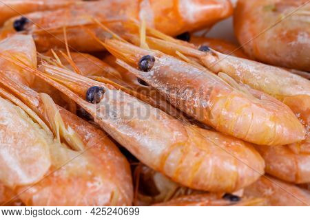 Close-up Boiled Unpeeled Shrimp And Prawns. Seafood Of The Order Of Crustaceans