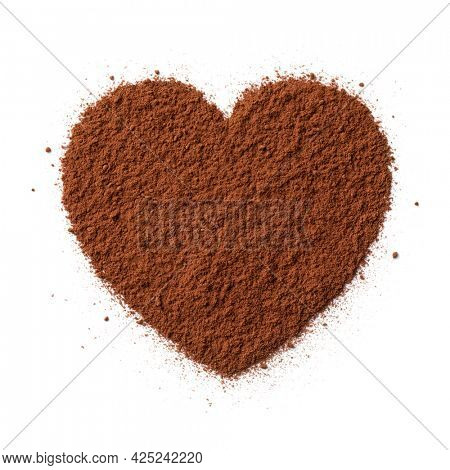 Brown cocoa powder in heart shape isolated on white background