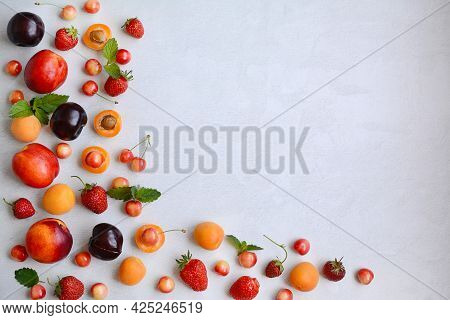 Seasonal Berries And Fruits - Cherries, Strawberries, Peaches, Plums, Apricots On A White Background