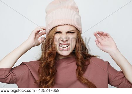 Picture of enraged dissatisfied young female grimacing and making angry gesture.