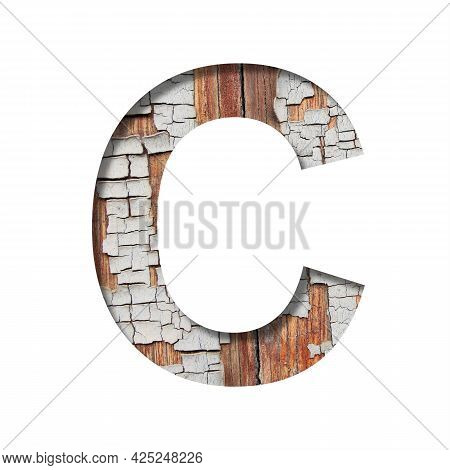 Vintage Backdrop Font.the Letter C Cut Out Of Paper Against The Background Of An Old Wooden Wall Wit