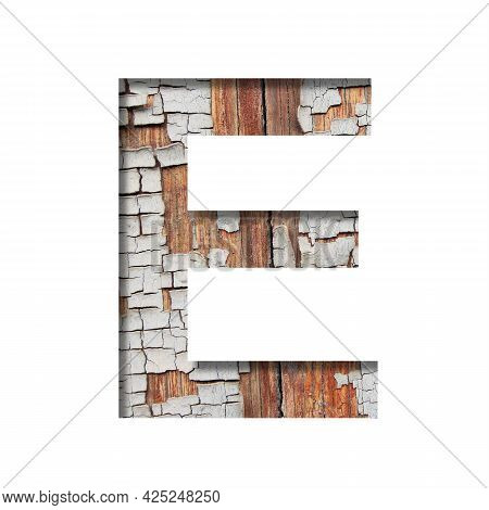 Vintage Backdrop Font.the Letter E Cut Out Of Paper Against The Background Of An Old Wooden Wall Wit