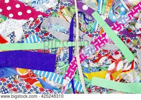 Texture Of Scraps Of Different Colored Fabrics As A Background Or Backdrop