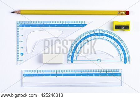 Set Of Simple Drawing Tools For Study Or Work On White, School Or Home Schooling Concept, Top View.