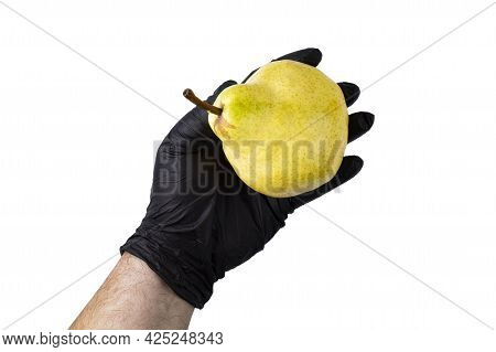 Ripe Large Pear In The Hand Of A Man In A Black Glove On A White Isolated