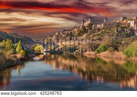 Toledo, Spain, March 27, 2019. Sunset View From The Tagus River Towards The Center Of The City, The