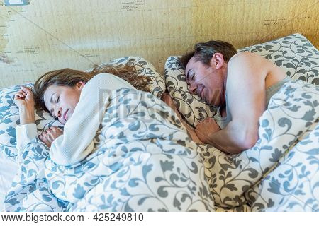 Mature Couple Sleeping In Bed. Resting Peacefully.