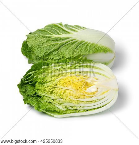 Whole and half fresh raw Chinese cabbage isolated on white background