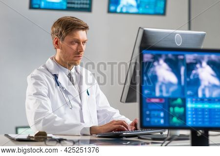 Professional Medical Doctor Working In Hospital Office Using Computer Technology. Medicine, Cardiolo