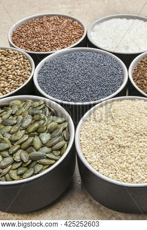 Various Seeds On A Marble Background. Assortment, Seeds Set, Healthy Food Ingredients, Superfoods, C