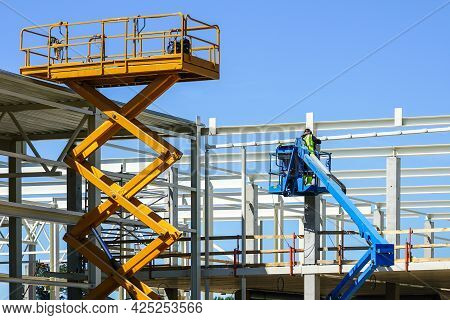 Modern Mobile Self Propelled Hydraulic Lifting Platform And Scissor Lift In Action