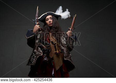 Barbaric Woman Pirate Holding Dual Flintlock Pistols