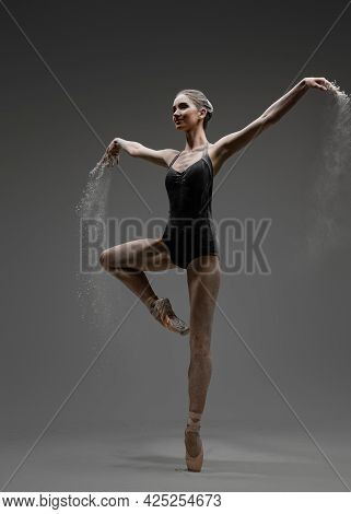 Attractive Ballerina Wearing Tutu Outfit Against Gray Background