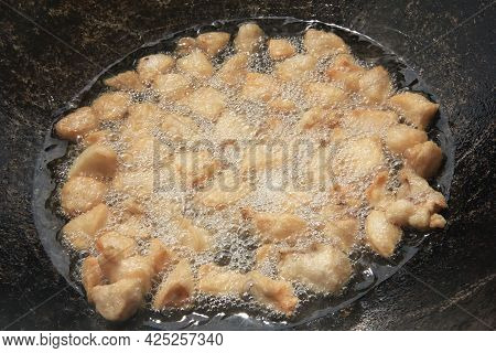Large Chunks Of Raw Lamb Fat Dumba Are Fried In Oil With Bubbles In A Black Cauldron Close-up, Cooki