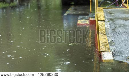Flooded House In The City Center. Street After Heavy Rain. Disaster Insurance Thematic Claim. Submer