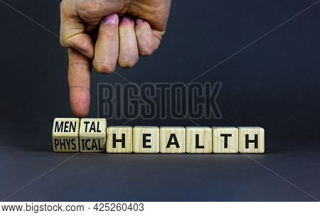 Mental Or Physical Health Symbol. Doctor Turns Wooden Cubes And Changes Words Physical Health To Men