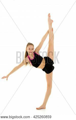 Gymnast Girl Doing Vertical Splits Holding Her Leg Up With Her Hand, Girl Wearing Tank Top And Short