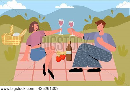 Couple In Love Enjoying Picnic Time And Food Outdoors Picnic Basket On Grass With Food And Drink On