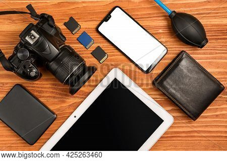Journalistic Equipment - Tablet, Phone, Camera, Lens, Wallet And Different Objects. Modern Investiga