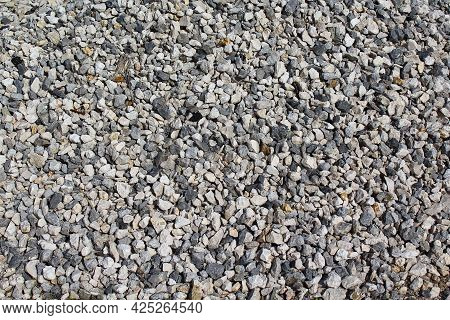 Small Stone Texture For Background. Gray Gravel Stones For The Construction Industry. Top View Of Gr