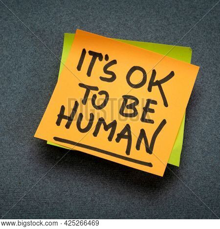 it is OK to be human - inspirational reminder note, emotions, vulnerability and personal development concept
