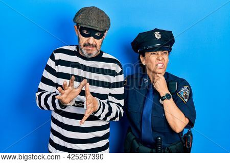 Middle age couple of hispanic woman and man wearing thief and police uniform touching painful neck, sore throat for flu, clod and infection