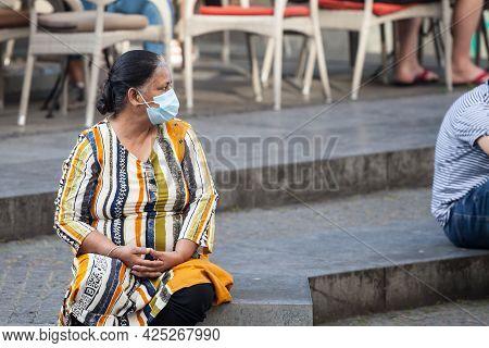 Belgrade, Serbia - June 26, 2021: Indian Tourist, Senior Woman From India, Sitting Resting In Belgra