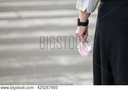 Selective Blur And Zoom On Female Hands Holding A Pink Facemask Respiratory Protective Equipment, De