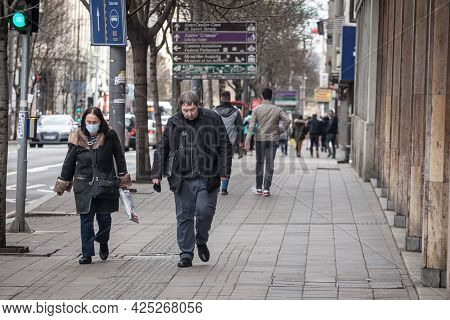 Belgrade, Serbia - March 6, 2021: Old Senior Woman Wearing A Respiratory Facemask  Next To A Younger