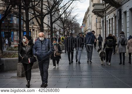 Belgrade, Serbia - March 6, 2021: Selective Blur On Old Senior Man And Woman, Couple, Wearing A Face