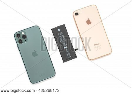 Russia, Rostov - May 29 2021: Different Modern Colorful Iphones And Put Out Uncharged Black Battery