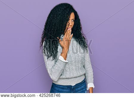 Middle age african american woman wearing casual clothes bored yawning tired covering mouth with hand. restless and sleepiness.