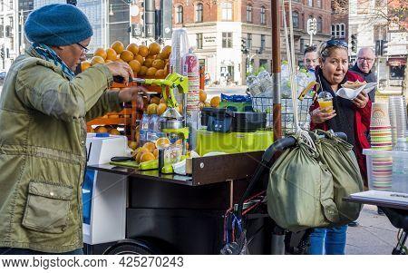Copenhagen, Denmark - Oct 21, 2018: Street Vendor Selling Freshly Squeezed Orange Juice And Bottled