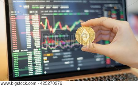 One Golden Ethereum Coin One Of The Cryptocurrency On Hand Business Woman  With The Cryptocurrency G