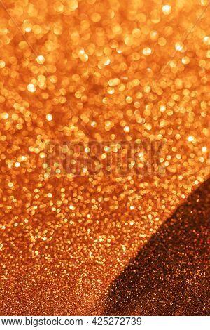 Glittery golden textured surface background
