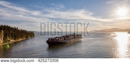 Vancouver, British Columbia, Canada - June 26, 2021: Aerial View From Above Of A Cargo Ship Arriving