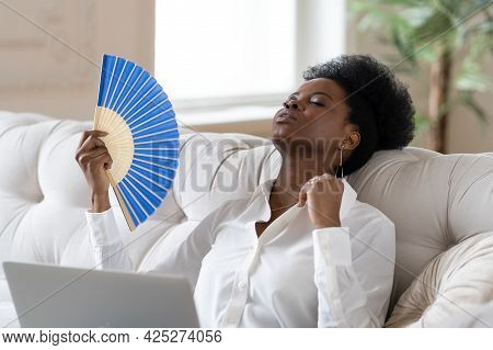 Tired Afro Business Woman Suffering From Heatstroke Or Hot Summer Flat Without Air-conditioner, Rest