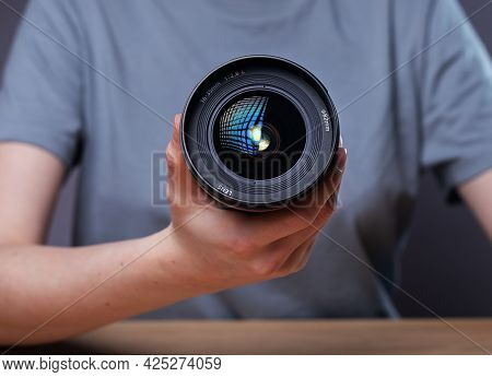 Modern Digital Camera Lens 35 Mm In Hands Of Female Photographer, Close Up.