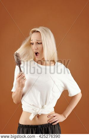 Distraught Young Caucasian Woman With Open Mouth Because Of Disappointment Holding Handle Of Brush S