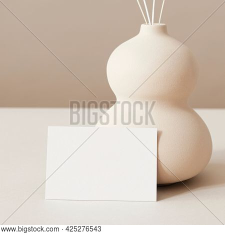 Business card design on beige background