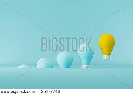 Light Bulb Yellow Floating Outstanding Among Lightbulb Light Blue On Background. Concept Of Creative
