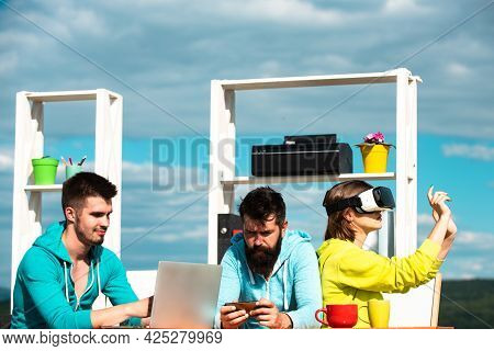 Vr, Technology And Business Concept. Team Of Three Professional Male And Female Designers Wearing Vr