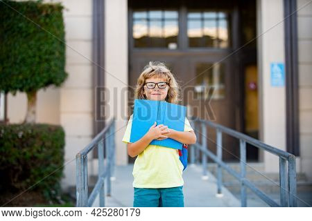 Kid From Elementary School. Happy Boy In Glasses Is Going To School For The First Time. Child With S